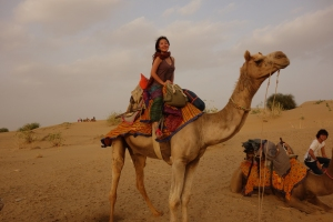 Joomi on a camel (Photo courtesy of Joomi Lee).