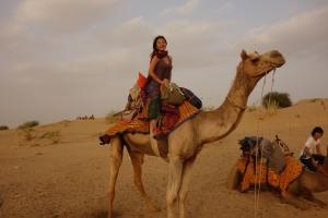 Joomi on a camel (Photo courtesy of Joomi Lee).