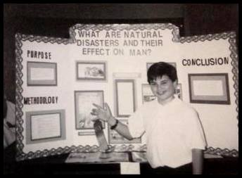 """Nic Matthews: """"I'm pretty sure this was the science fair competition where 5th graders write up a brief paper on a subject of their choice and present the topic to judges. Surprisingly, it's like the high-density poster sessions we go to at conferences. As you can see, I did my project on natural disasters and their effects on humans. It may look rough, but I earned 1st or 2nd. I can't remember. I was a nerd because I was always into anything science. My room growing up was crazy--I had a telescope, computers, microscopes, chemistry set, robots I built, a rock collection, posters of space and DNA, and on and on. In fact, my prized possession growing up was a vial of Martian dust from a meteor. I had it bad..."""""""