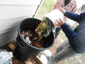 "Ben dumping scraps of ""green"" into the compost bin"